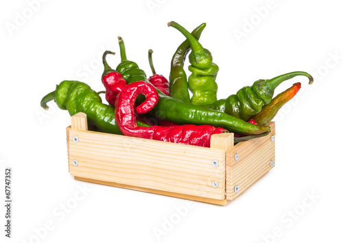 canvas print picture Spicy hot peppers in a wooden box