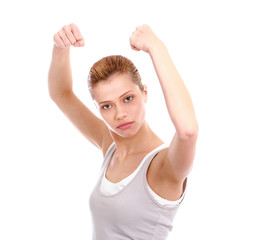 Portrait of young woman standing and raising her hands