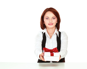 Business woman with gift box red bow sitting at the desk