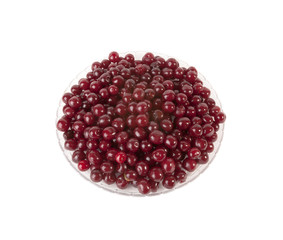 Fresh red Cherries in glass plate on white