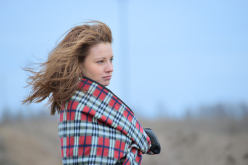 Woman in plaid with flying hair