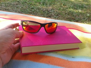 Relax with book and sunglasses