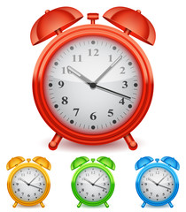 Collection of 4 color alarm clocks.
