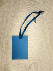 blue  paper envelope with blue ribbon