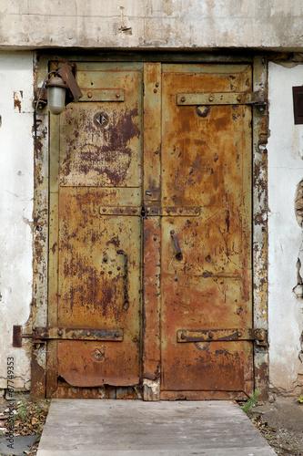 rusty old metal door in an abandoned factory