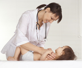 Beautiful doctor with little girl