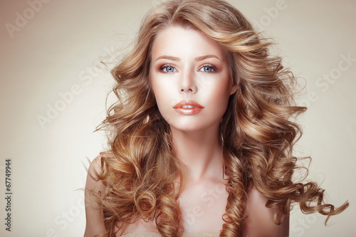 Portrait of Woman with Beautiful Flowing Bronzed Frizzy Hair