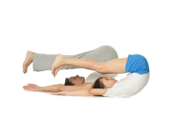 Exercising mother and son isolated