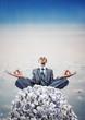 Businessman meditating on heap of documents