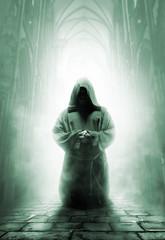 Praying medieval monk in dark temple corridor