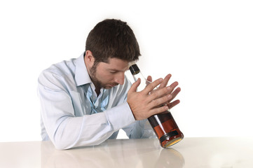 alcoholic drunk businessman drinking whiskey bottle