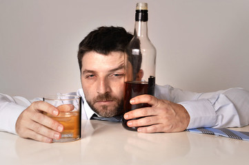 alcoholic drunk businessman wasted and whiskey bottle