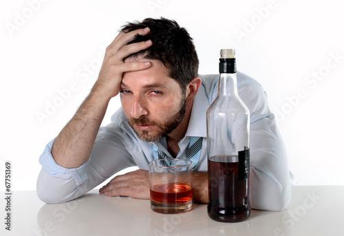 Leinwanddruck Bild drunk businessman wasted drinking alcohol suffering hangover