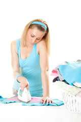 Beautiful housewife ironing