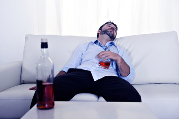 alcoholic drunk business man whiskey wasted in couch