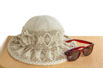 Female summer hat for protection against the sun on a white back