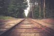 canvas print picture - Retro toned rural railroad tracks