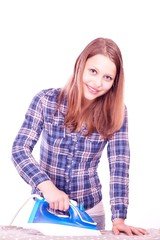Teen girl ironing clothes