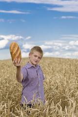 Happy child holding bread