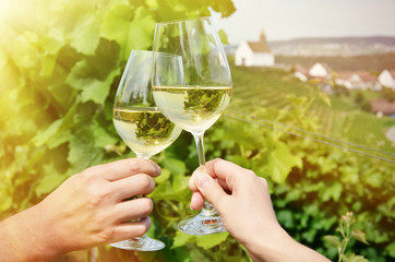 Pair of wineglasses against vineyards in Rheinau, Switzerland