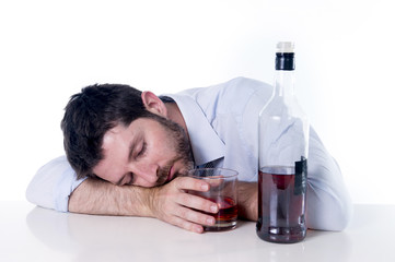 alcoholic Businessman sleeping drunk at desk