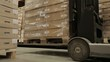 Picks up pallets with goods