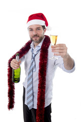 happy businessman drinking champagne in santa hat