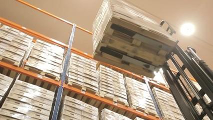 Loader picks up pallets with goods