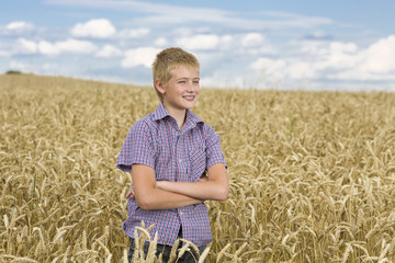 Happy little boy and wheat