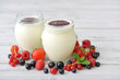Yogurt with ripe fresh berry
