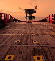 rig platform silhouette in oil and gas industry when sunset