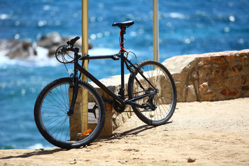 Bike locked on the seashore