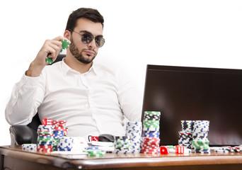Playing poker online via laptop