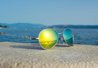 Sunglasses with sea reflection