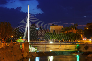 Pedestrian bridge over Segura river in night. Murcia