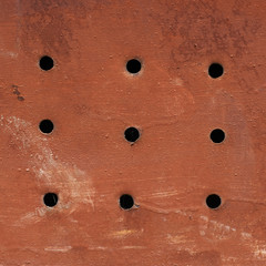 Painted grungy metal surface with holes