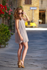 beautiful woman in summer dress walking and running joyful and c