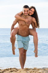 Lovers couple at sea shore