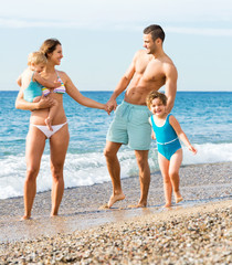 Family with two kids on beach