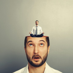 amazed businessman with open head
