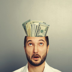 amazed man with money in the head
