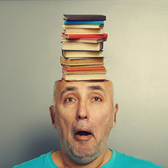 senior man with books in the head