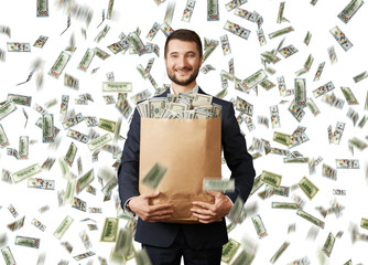 smiley businessman with money