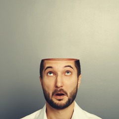 surprised man looking up at his open empty head