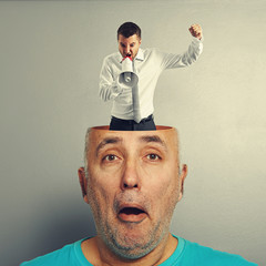 surprised man with angry businessman
