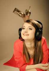 Technology, music - smiling teen girl in headphones