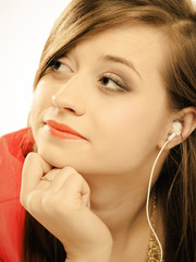 Technology, music - teen girl in earphones