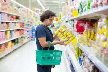 Man checking food labelling