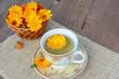 Herbal marigold tea with flowers