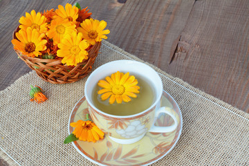 Herbal marigold tea with flowers